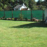 tuin met windbreeknet groen